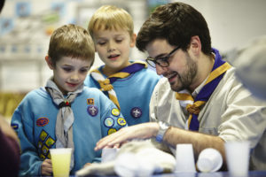 A leader supporting Beaver Scouts
