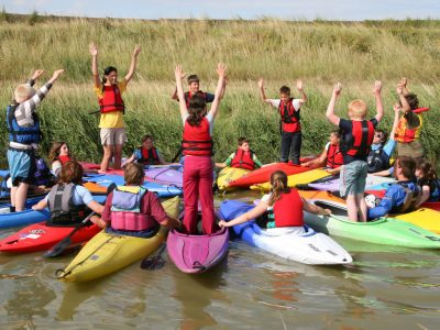 Young People in Kayaks