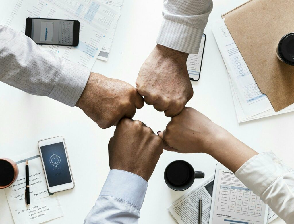 Productive employees's hands coming together in teamwork within a value-aligned company