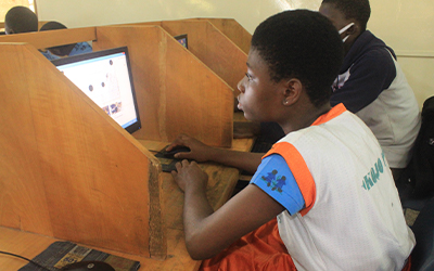 An SOS female student behind a computer