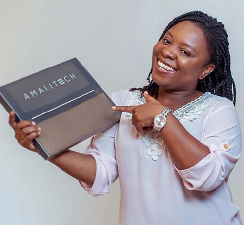 Lady displaying an AmaliTech folder