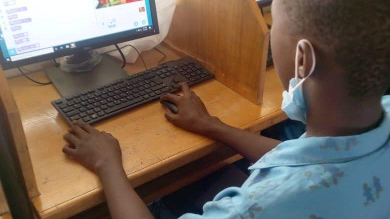 child coding on computer