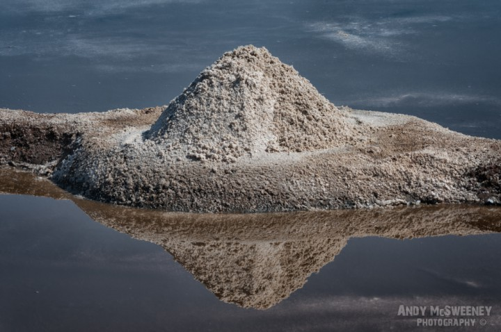 Salt pile and surrounding water in the salt fields of Gokarna, South-India 2010