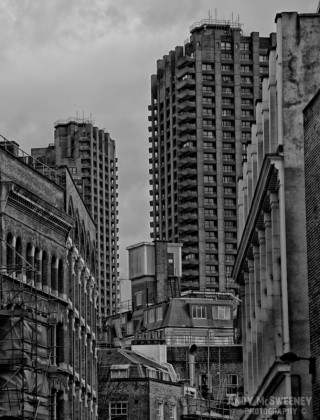 Black and white photo of the street and the towers on the Barbican in London, United Kingdom
