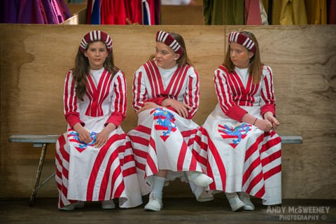 Three girls in costume waiting on a bench at the rehearsal of the Holy Blood Procession in Brugge, Belgium 2015