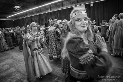 A black and white photo of dancing girls in costume practising their act at the rehearsal of the Holy Blood Procession in Brugge, Belgium 2015