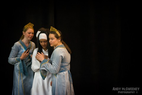 Three girls in costume practising their act at the rehearsal of the Holy Blood Procession in Brugge, Belgium 2015