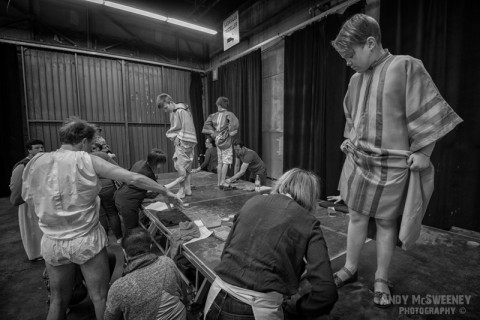 A black and white shot of the figurants getting their costumes ready at the rehearsal of the Holy Blood Procession in Brugge, Belgium 2015