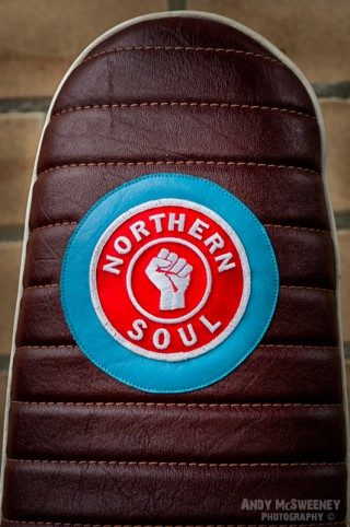 A Northern Soul patch on a leather seat of a Vespa scooter during Mod Days Brugge, Belgium
