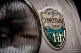 Detail shot of a Innocenti Lambretta sign on a vintage scooter during Mod Days Brugge, Belgium
