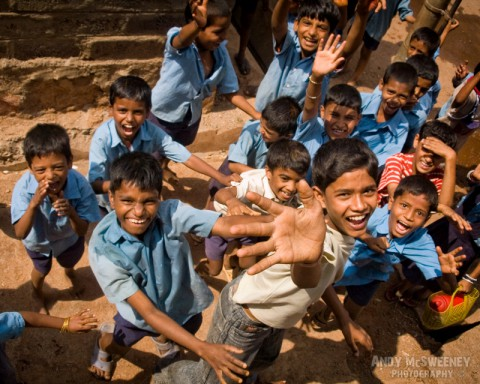 Portrait of happy waving Indian school boys on the streets of South-India