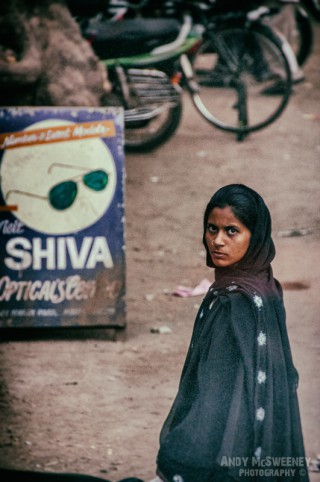 Portrait of an Indian lady in sari with intense stare on the streets of South-India