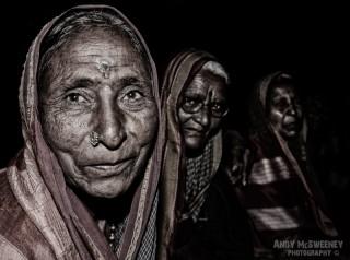 Colorful portrait of three Indian ladies in sari in South-India
