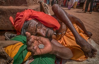 Colorful portrait of a begging handicapped untouchable Indian man during Shivaratri ceremony in Gokarna, South-India