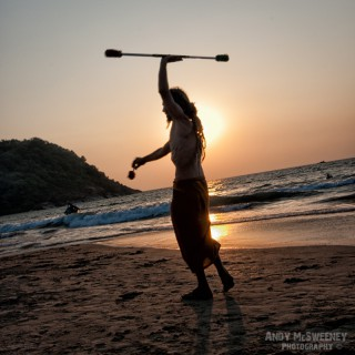 Hippy traveller performing on the beach by sunset in South-India
