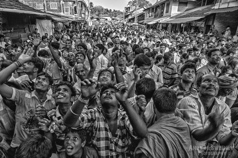 Black and white portrait of an Indian crowd catching and throwing bananas during Shivaratri festival in Gokarna, South-India