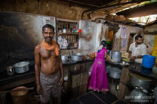 Colorful portrait of the chef and his crew and kitchen in a vegetarian restaurant in Gokarna, South-India