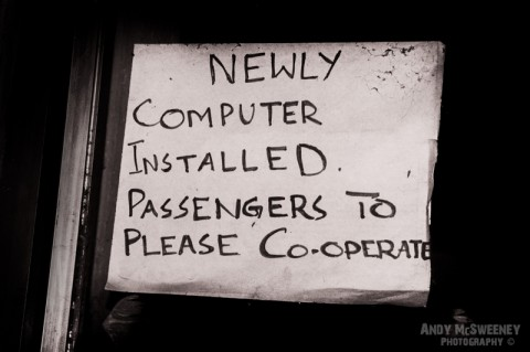 "Black and white paper sign at internet café saying ""Newly Installed Computer"" in India"