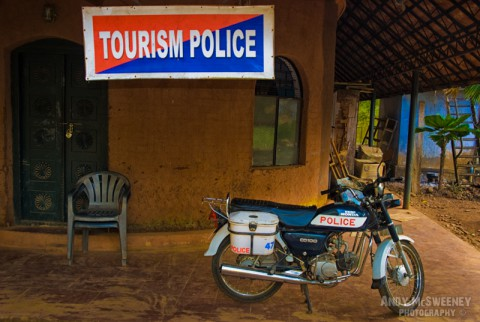 """Colorful """"Tourism Police"""" sign at the police station in India with motorbike in the front."""