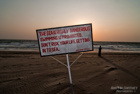 """Beach police sign in India, Gokarna saying """"Don't Risk Your Life Getting In To Sea"""""""