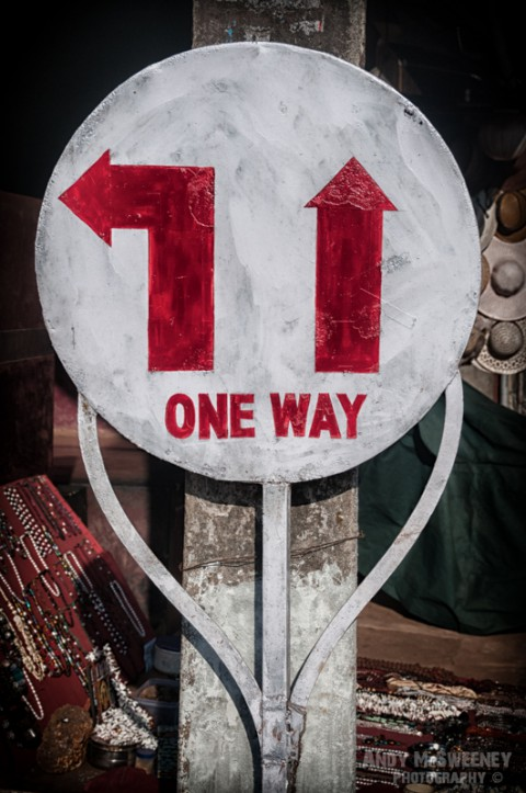 """Red and white street traffic sign In India saying """"One Way"""""""