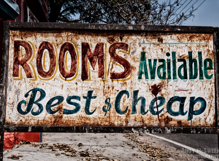 """Old colorful street sign in India saying """"Rooms Available, Best & Cheap"""""""