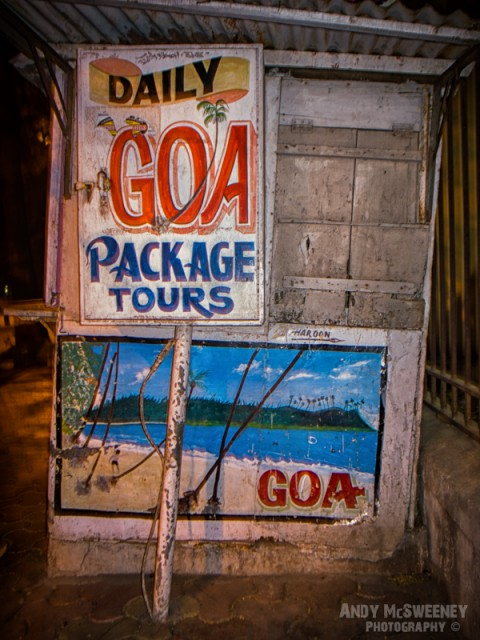 "Colorful street advertising sign offering ""Daily Goa Package Tours"" in Goa, India"
