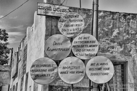 """Six black and white street signs in Hampi, India regarding """"Citizen's Rights Protection"""""""