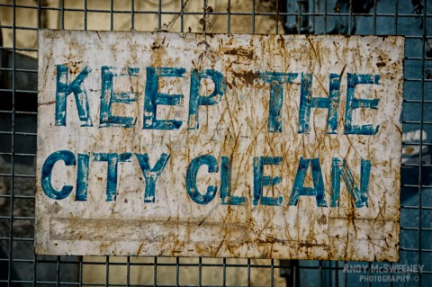 """Old colorful street sign in India saying """"Keep The City Clean"""""""