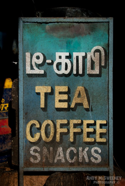 Colorful street sign for a shop offering tea, coffee and snacks in India