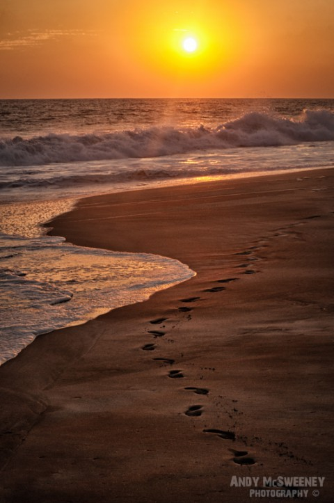 Footsteps in the sand at sunset in India