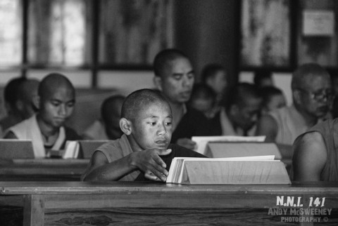 Black and white portrait of little monks during study in the monastery of Bylakuppe, South-India