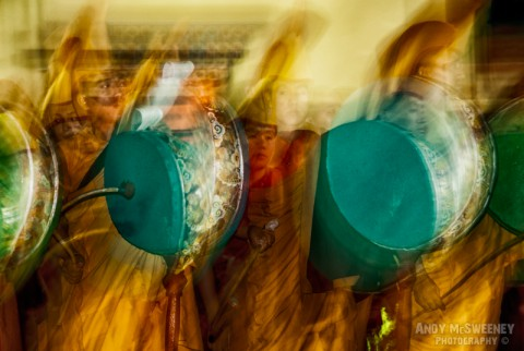 Blurry colorful portrait of monks during puja ceremony in monastery of Bylakuppe, South-India