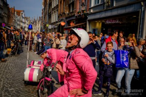 The Pink Police street performers doing their act during the Steenstraat Braderie in Brugge, Belgium 2015