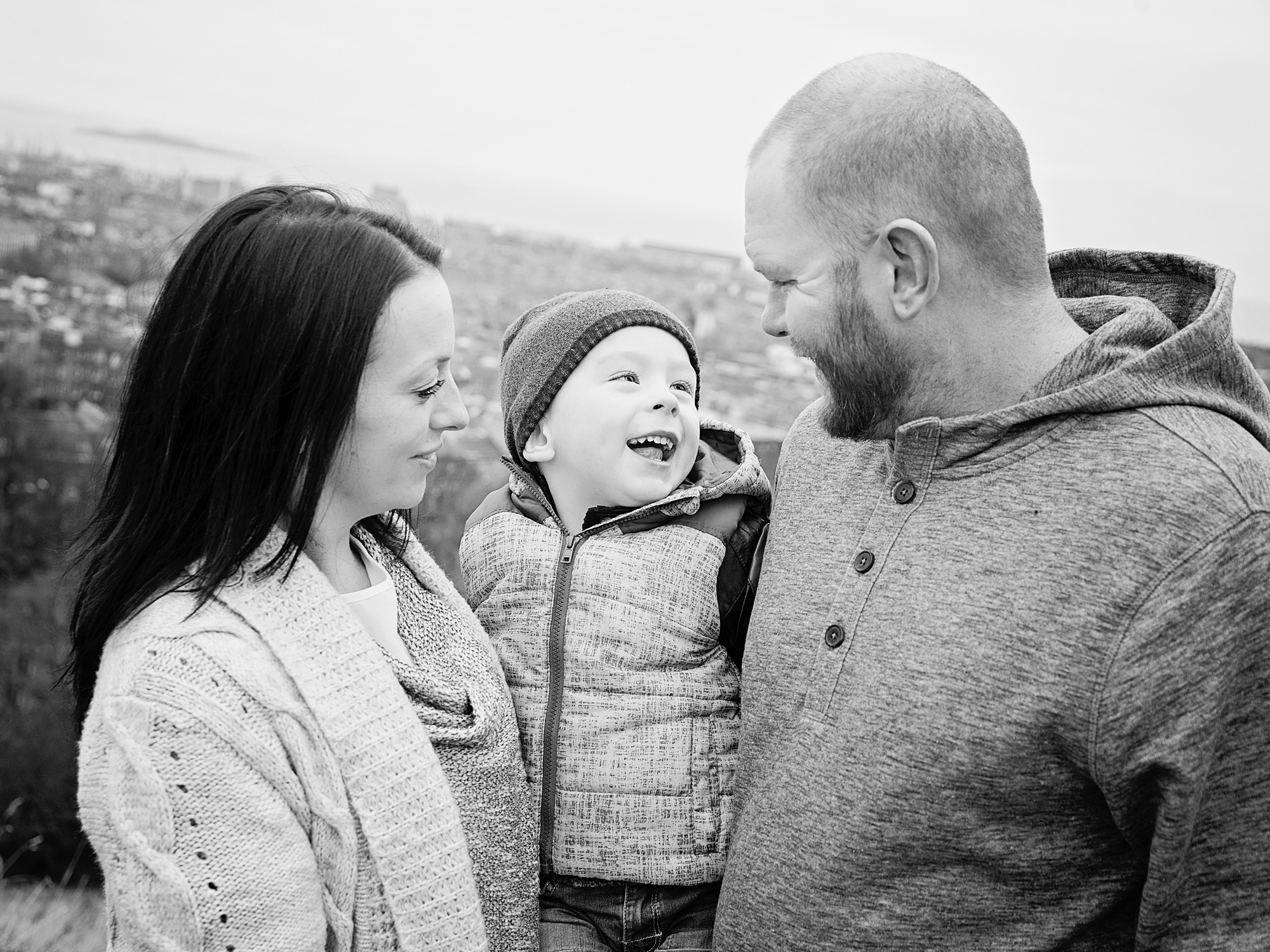 black and white portrait family laughing