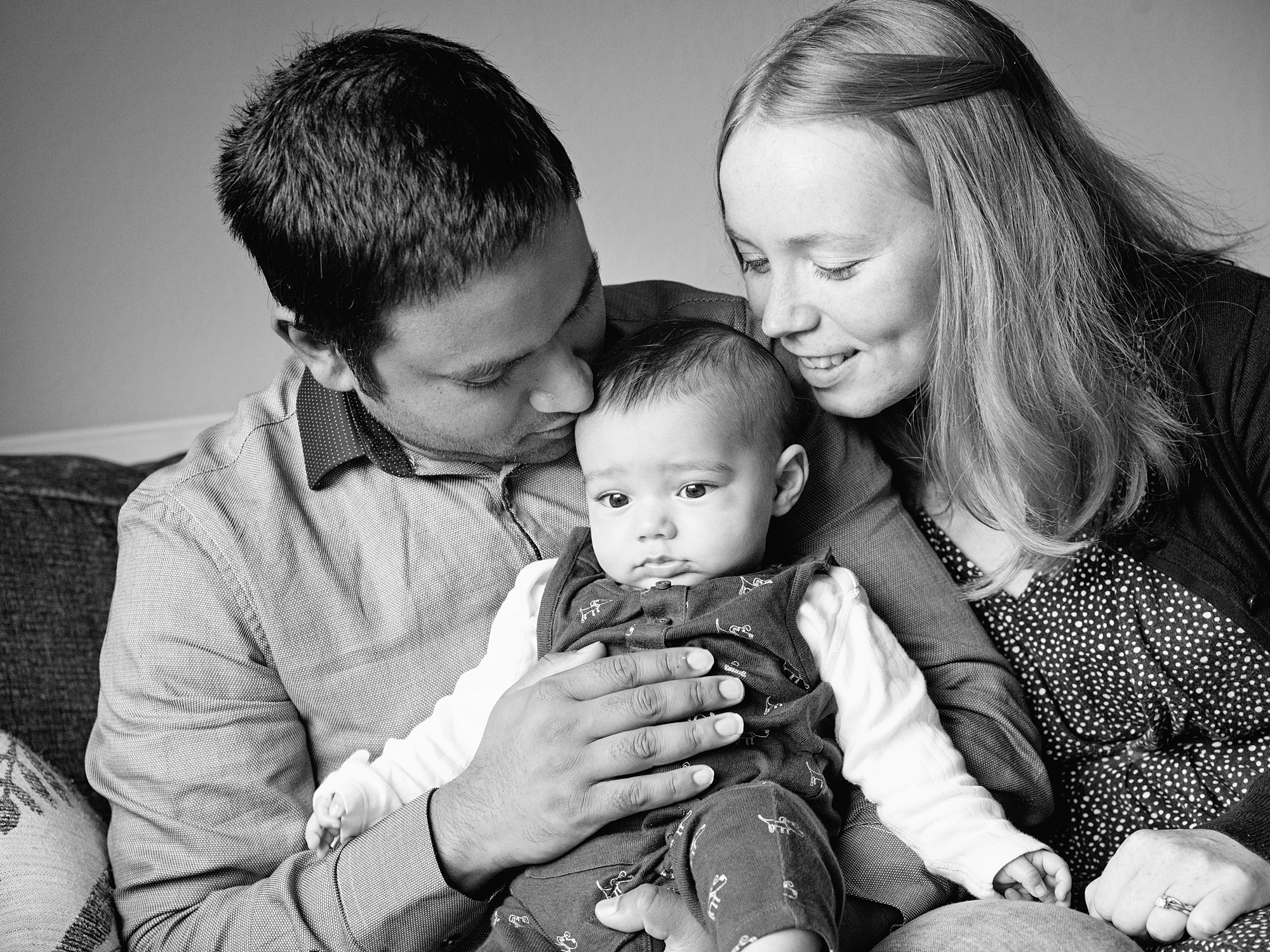 dad and mum snuggling with baby at home lifestyle family photography in edinburgh midlothian