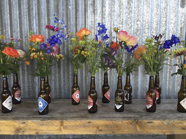 Flowers in beer bottles