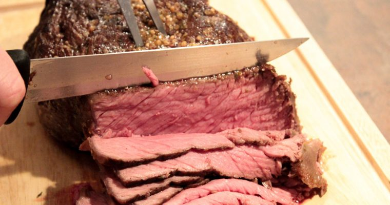 Juicy roast beef with mustard seeds and cranberries