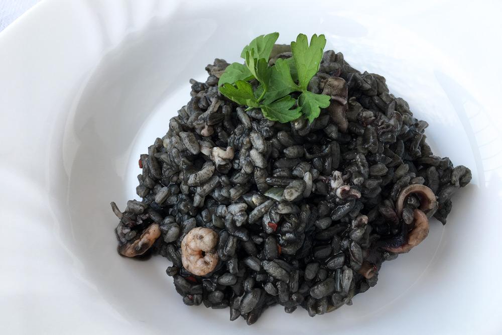 Porcia sépiového rizota