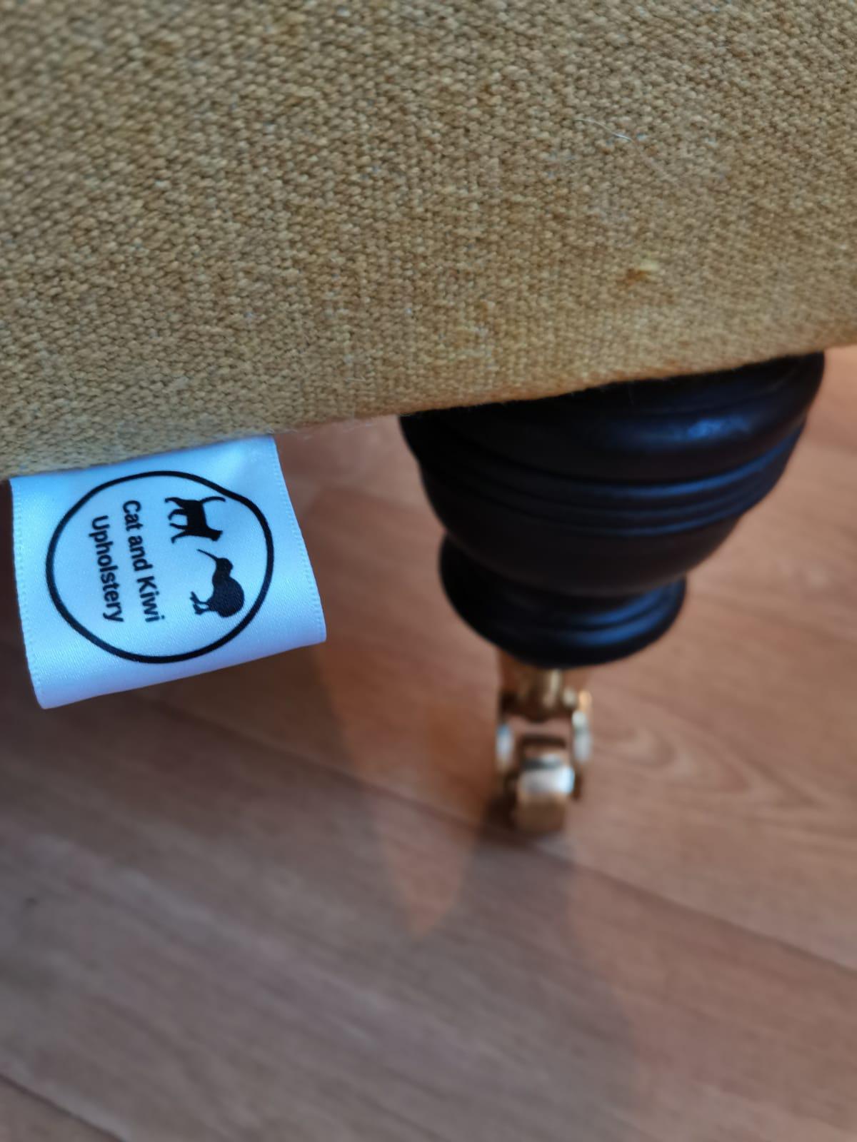 cat and kiwi label on sofa