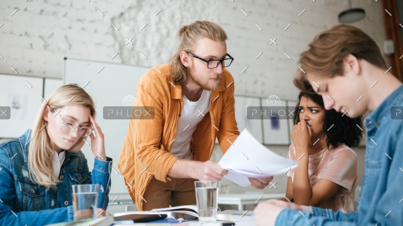 demo-attachment-292-group-of-upset-students-sitting-at-the-table-with-E5YW9L4