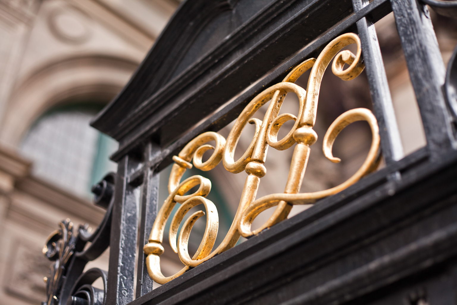 Close up of the gate of Central LIbrary: EPL in swirly gold letters