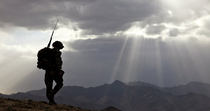 US Army Spc. Newton Carlicci travels dismounted while on his way back to his outpost from the village of Paspajak, Charkh District, Logar province, Afghanistan. File photo