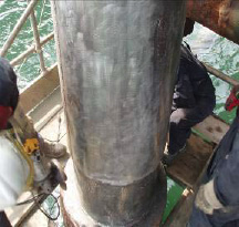 The riser is cleaned to remove all surface contaminants, revealing clean, white metal per NACE 3 surface preparation and is ready for the installation of the Clock Spring repair sleeve