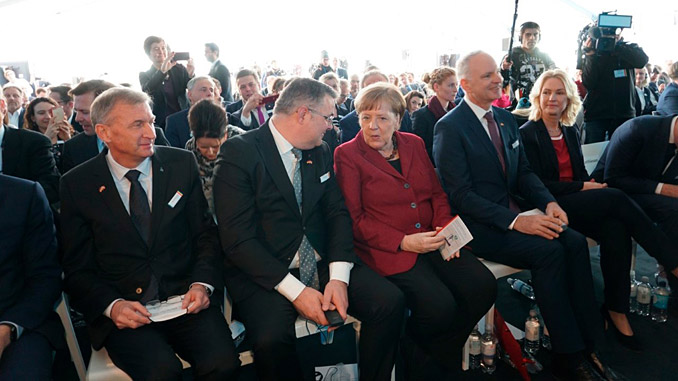 From left, Chair of the Equinor board, Jon Erik Reinhardsen, Norwegian petroleum and energy minister Kjell-Børge Freiberg and Chancellor of Germany Angela Merkel at the opening of the Arkona offshore wind farm