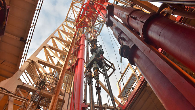 Derrik on a rig during Hurricane's drilling operations