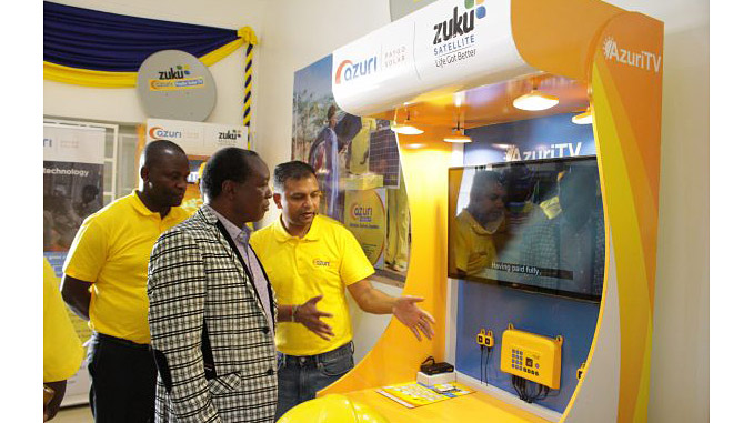 Daniel Okia, Chief Officer, Ministry of Energy and Industrialisation, Kisumu County (left) and Snehar Shah, General Manager for Azuri East Africa, officially open the Azuri's new Off-grid Solar Centre in Kisumu