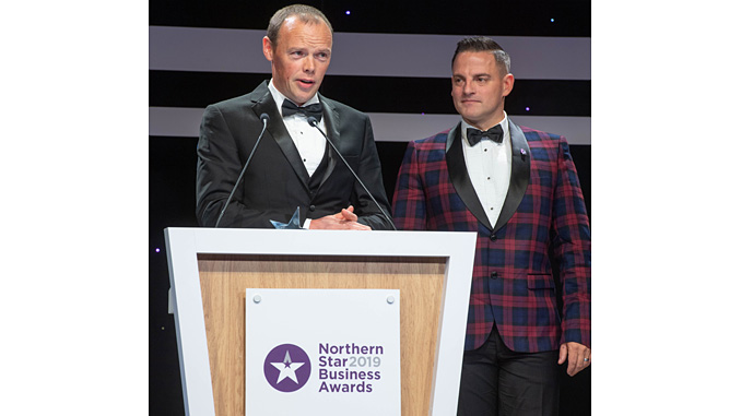 Motive Offshore Chief Operating Officer, James Gregg and Chief Executive Officer Dave Acton collecting the award