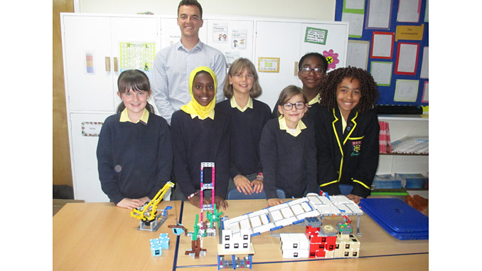 John Polson, Assistant Project Manager at ROVOP, with team members from St Margaret's School for Girls