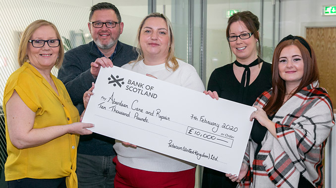 One very big cheque – from left, Karen Milne, Project Manager at Aberdeen Care and Repair Services; Stuart White, Regional Director at Peterson; with Magdalena Konieczna, Laura Mutch and Jodie Ewen of Peterson's charity committee